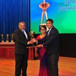 Mr D V Abeysinge receiving the Award from Dr Harsha De Silva